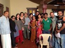 Participants of the cluster meeting with the cast and crew on the sets of a local film production
